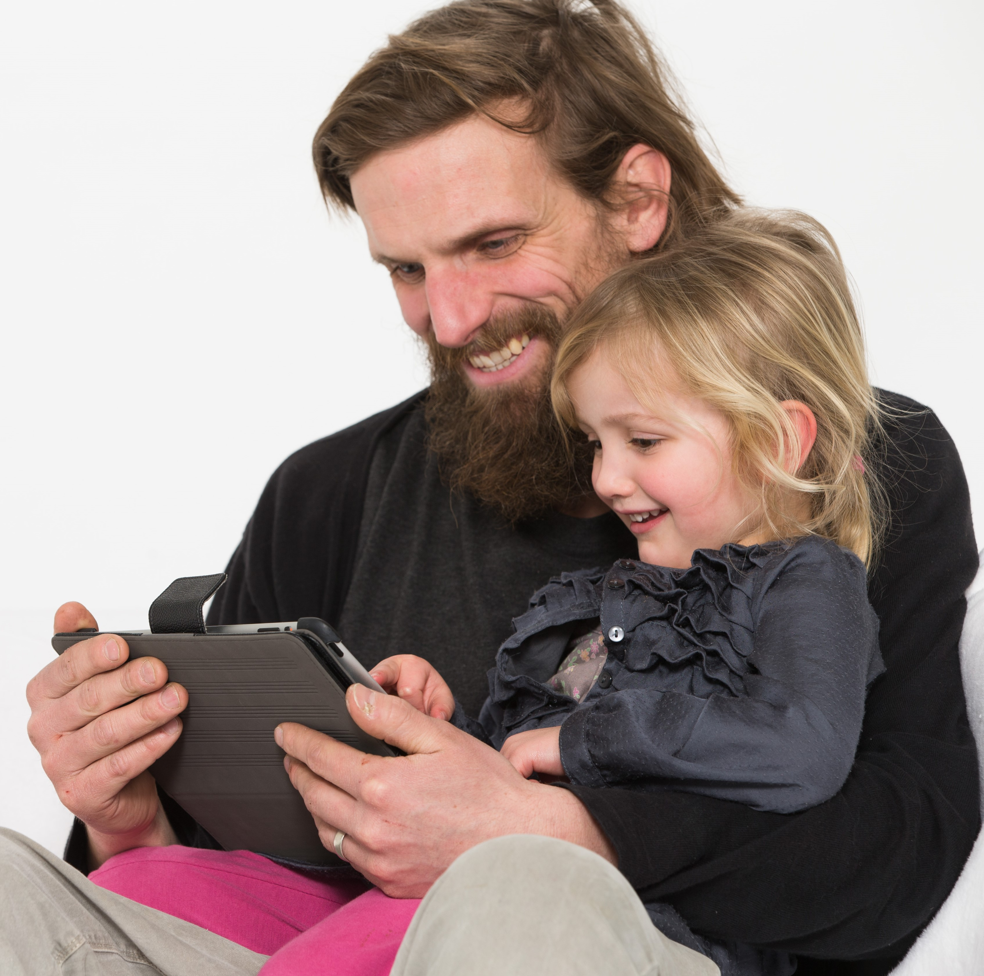 Dad and daughter sharing screen time together