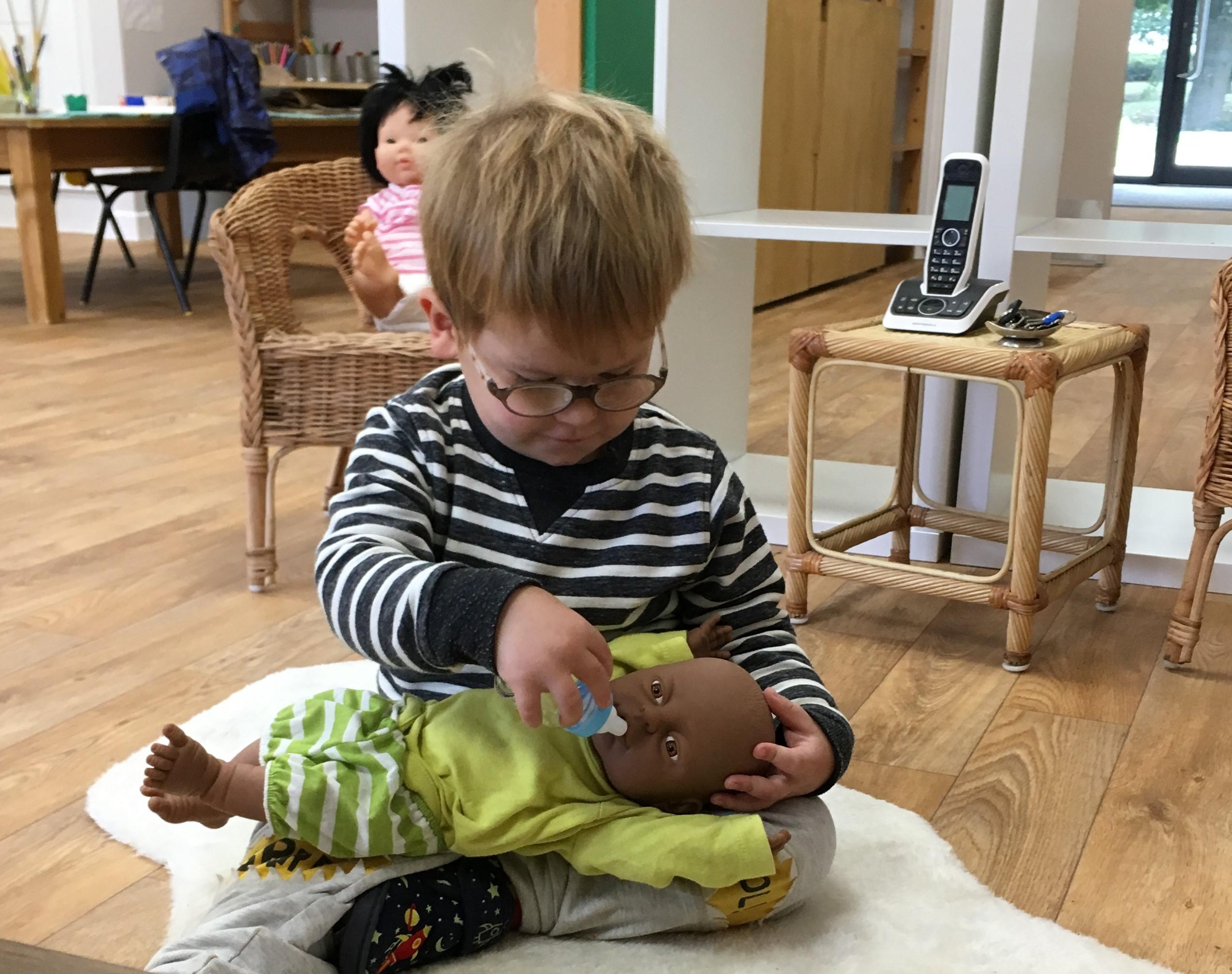 Little Peeple Nursery - feeding baby doll