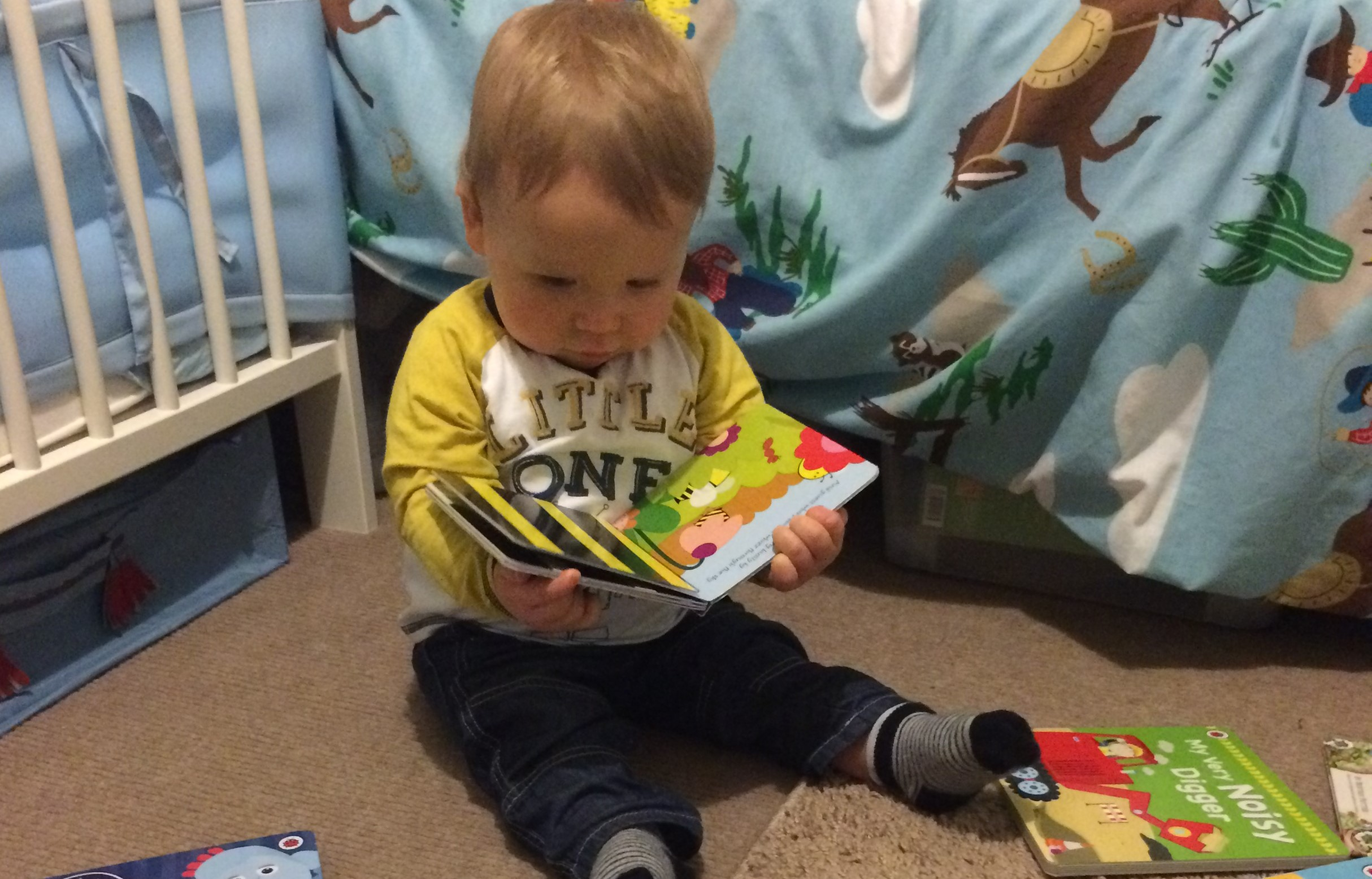 Reading his favourite Peep Imagination Library book