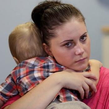 baby and mum cuddle