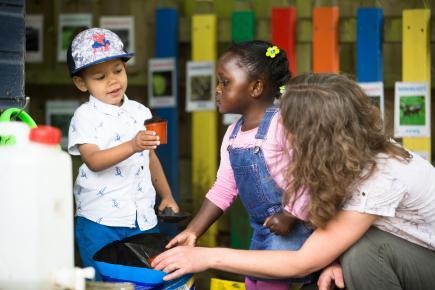 planting seeds together at preschool