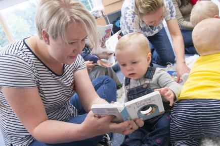 Mum reads with baby