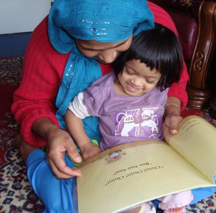 mum and child sharing a book
