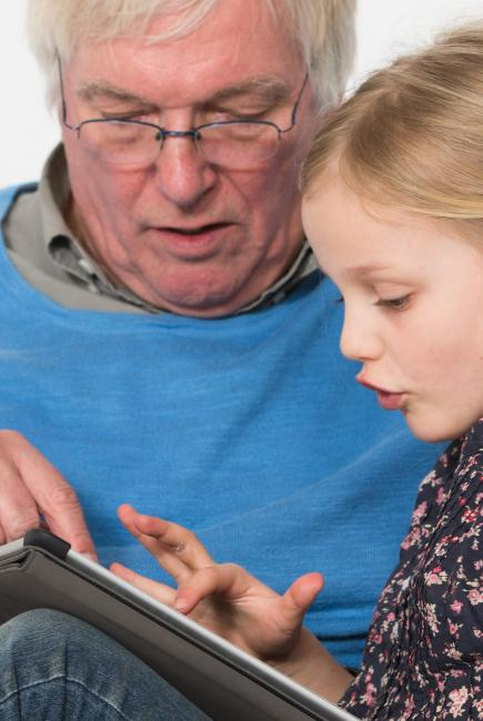 interacting with tablet and grandad