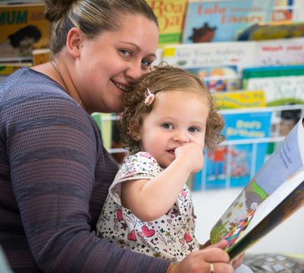 mum and daughter reading