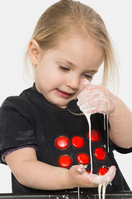 toddler playing with gloop