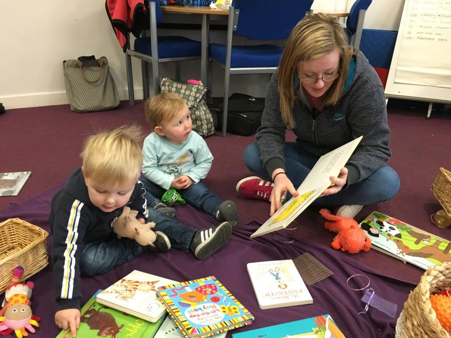 Pupil and child read together