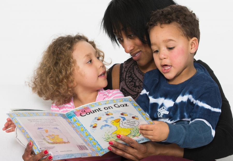 children and mum sharing a book