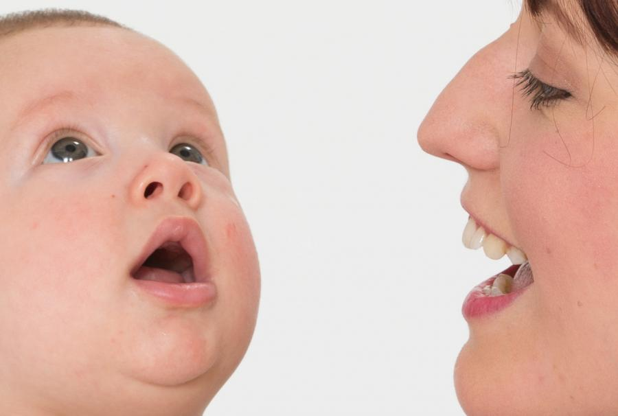 Mum copying mouth shape of baby